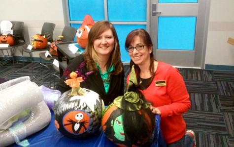 Staff dress up pumpkins for 'Little Friends'