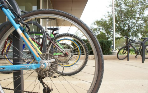 Bikes line up the racks near the Student Services Center of College of DuPage.