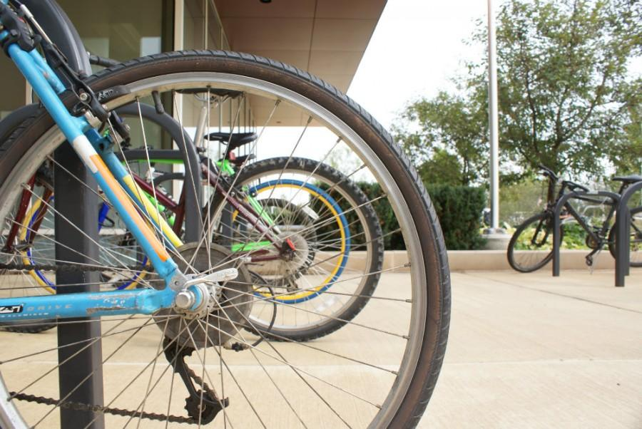 Bikes+line+up+the+racks+near+the+Student+Services+Center+of+College+of+DuPage.