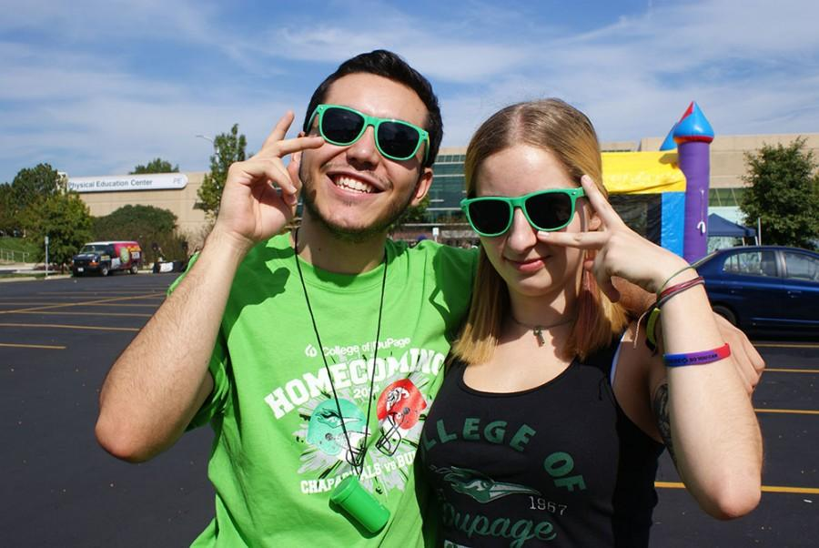 Daniel Rodriguez, left, and Rachel Musselwhite enjoy pre-game festivities.