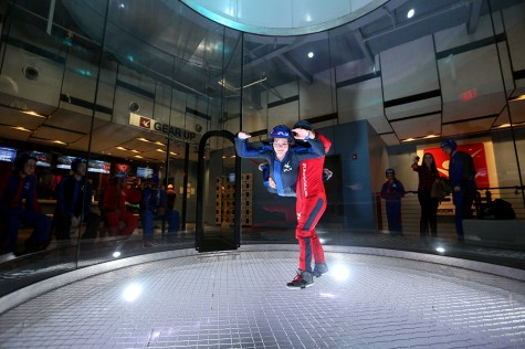 Courier features editor Kelly Wynne flies in a wind tunnel. Photo courtesy of iFLY.