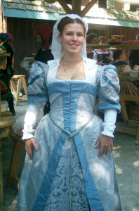 Melissa Heischberg wearing a Grey Middle Class Kirtle and Gown in a Renaissance fair.