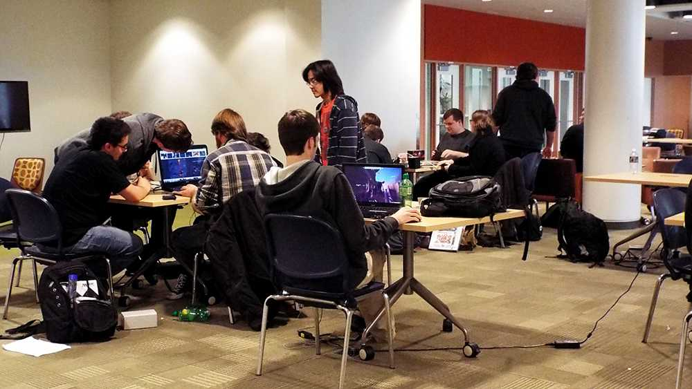 Students congregate in a study area at College of DuPage.