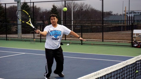 Alan Bui going for a volley at practice at the College of DuPage on March 19.