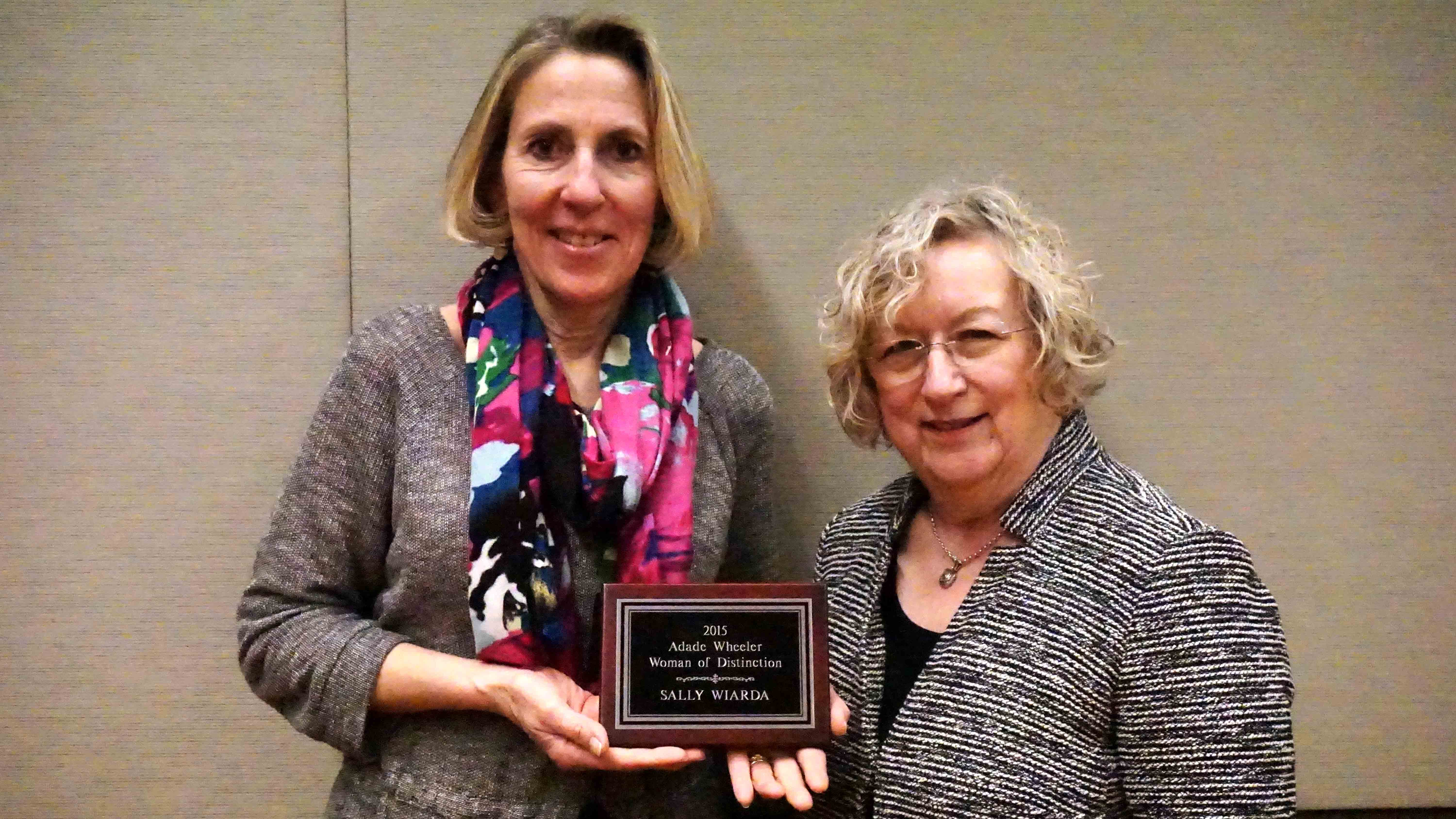 Sally Wiarda, left, is pictured with her award and her nominator, Charlotte Mushow. Wiard was named the Woman of Distinction by COD's Studies Committee.
