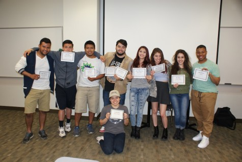 Students pose with certificates during a LEAA meeting. LEAA, a student group on campus, aims to connect the growing Latino student population.