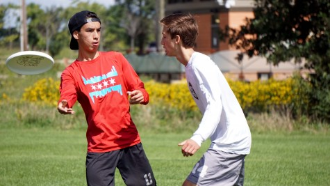 Jerry Kelly throws a disc past Alex Biskus during a game of Ultimate Frisbee at Knock Knolls Park in Naperville, Ill on Sept. 12.