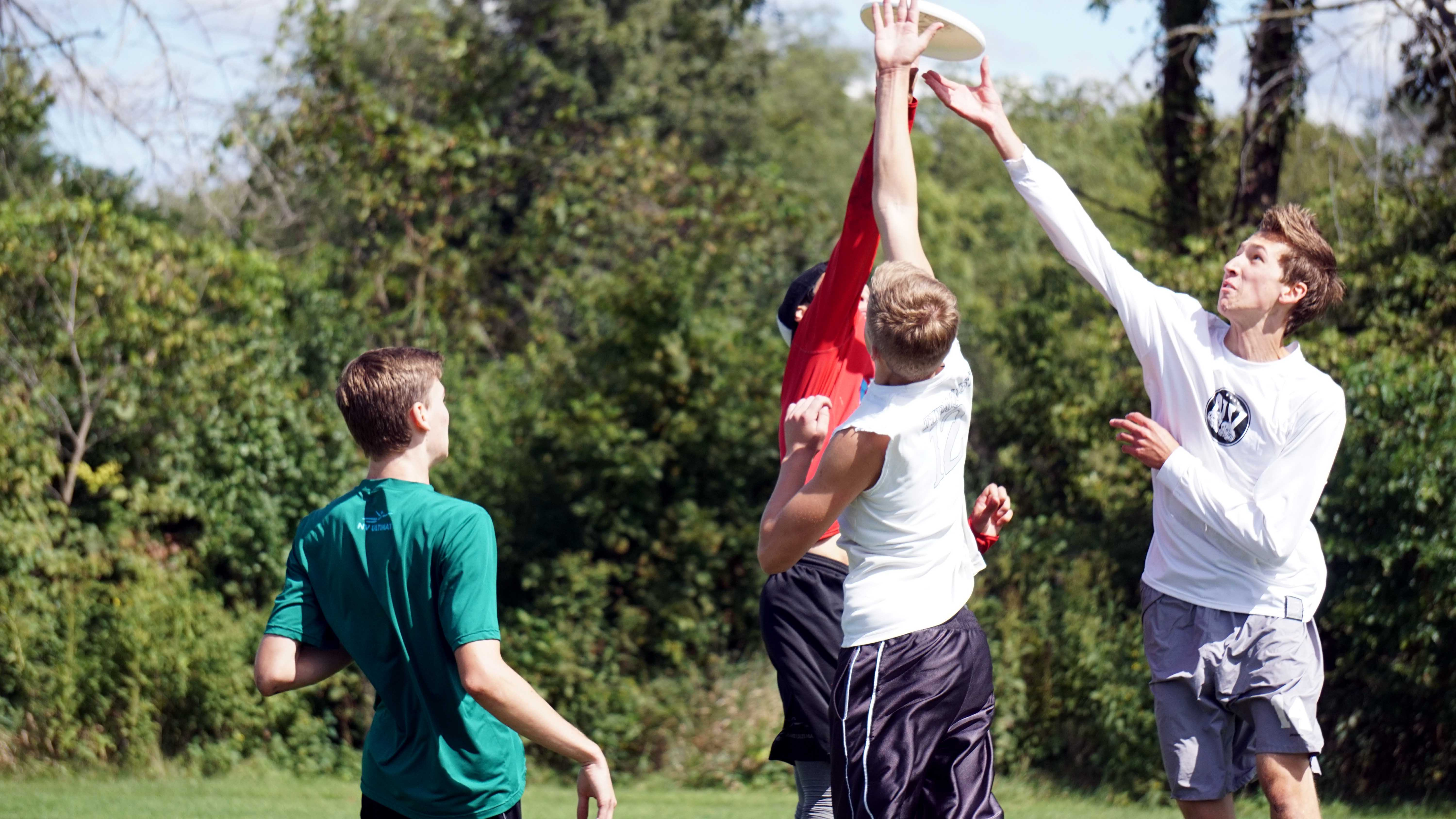 A group of players jump for the disc during an Ultimate Frisbee game at Knock Knolls Park in Naperville, Ill on Sept. 12.