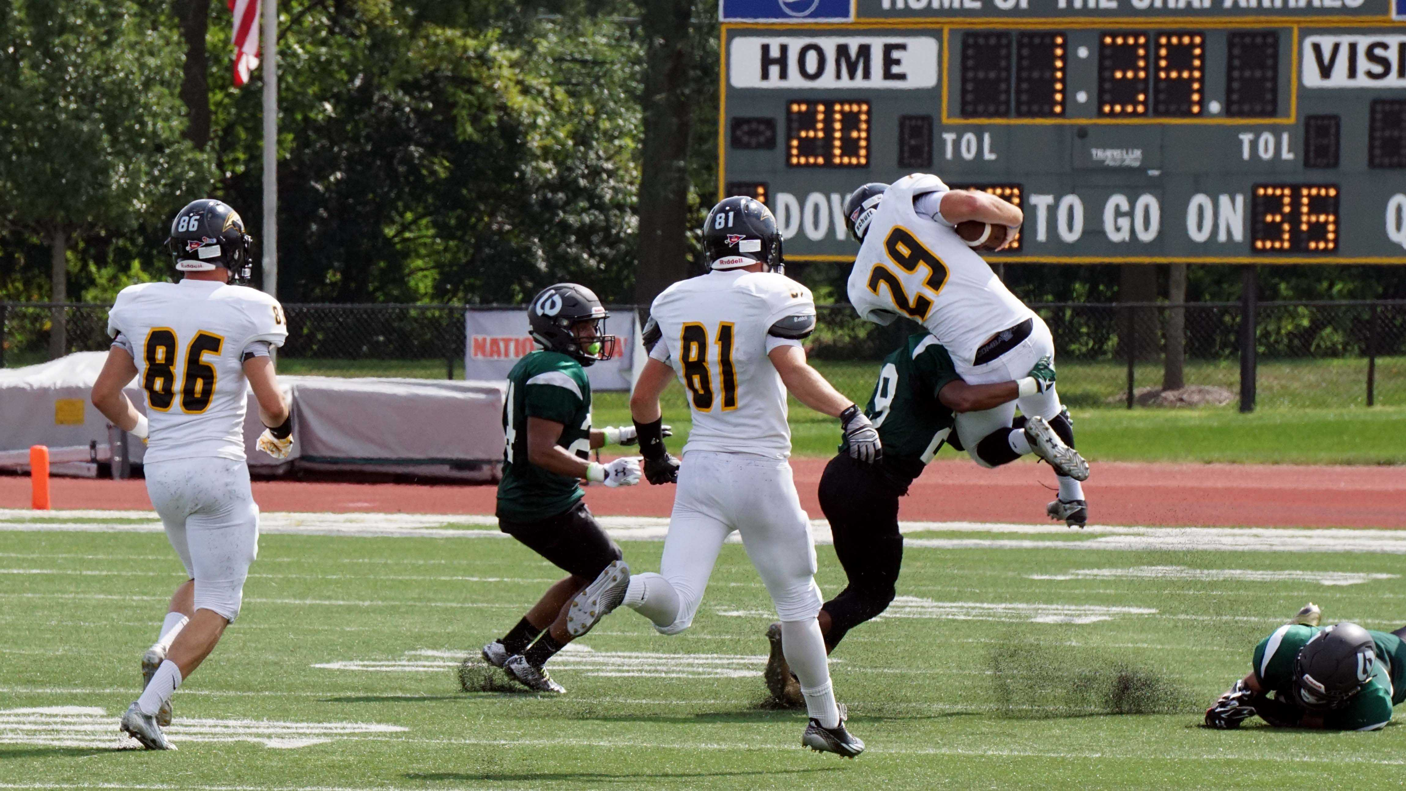 Defensive Back #29 Kyler Davis takes down University of Wisconsin Oshkosh player at the College of DuPage on Sept. 7.