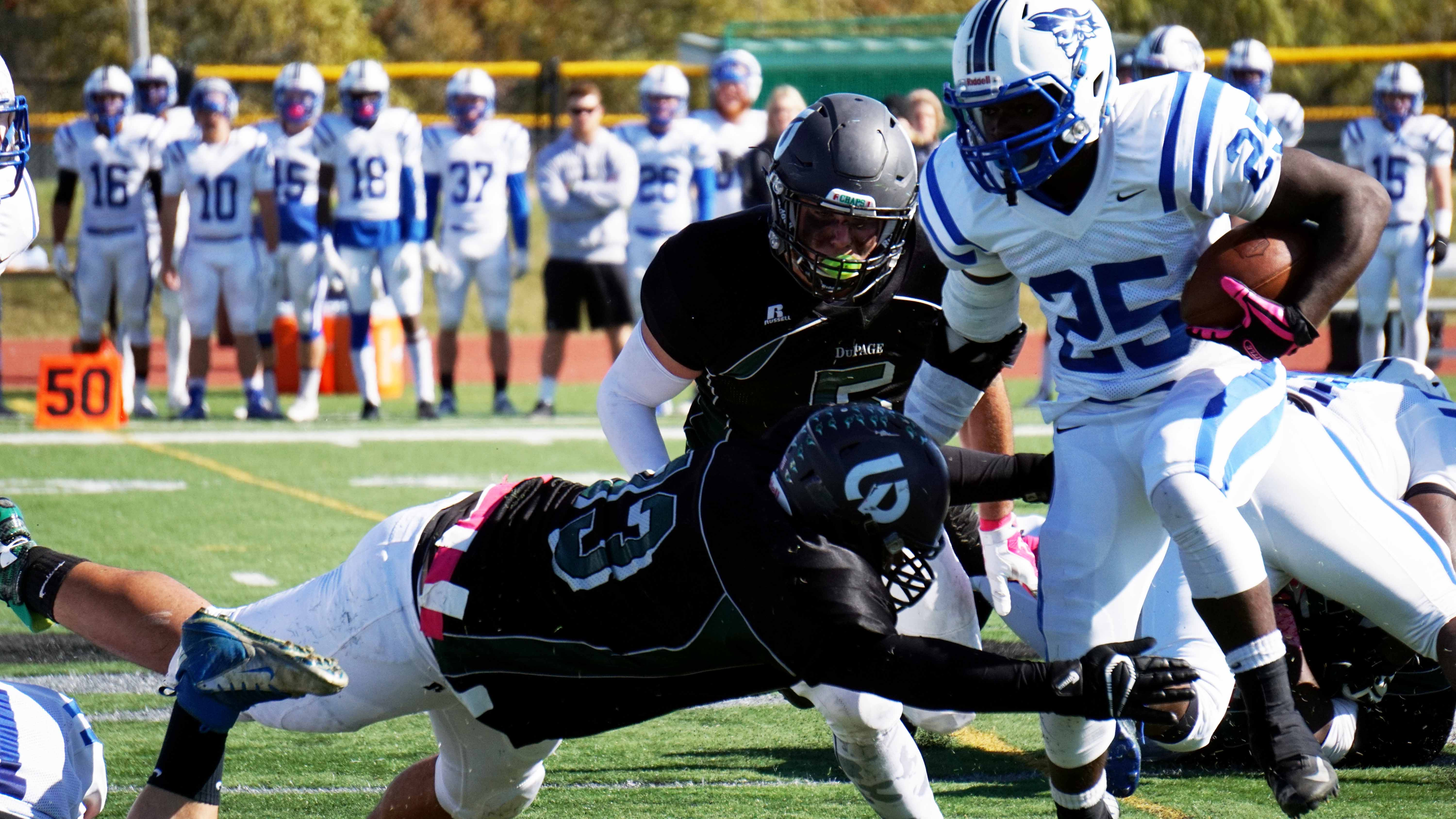 Chaparral Defensive Back Mitch Boals tries to take down Iowa Western Reiver Running Back Jon Nzombo at the College of DuPage Homecoming match on Oct. 17.