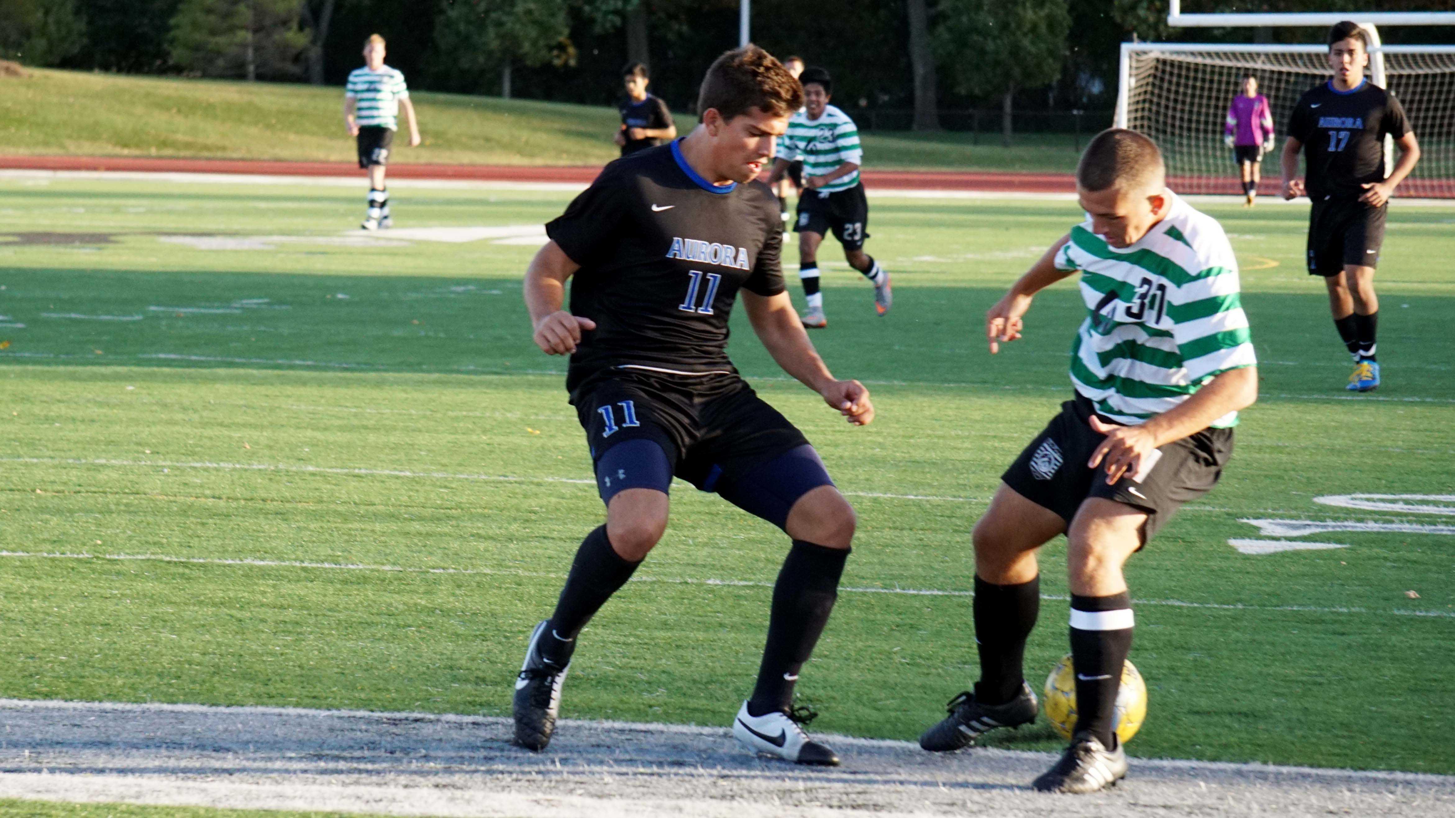 Chaparral Midfielder Zoran Tanasic juking past Aurora University JV Defender at the College of DuPage on Oct. 15.