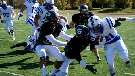 Chaparral player pushed Iowa Western Reiver running back Ray Gray at the College of DuPage Homecoming match on Oct. 17.