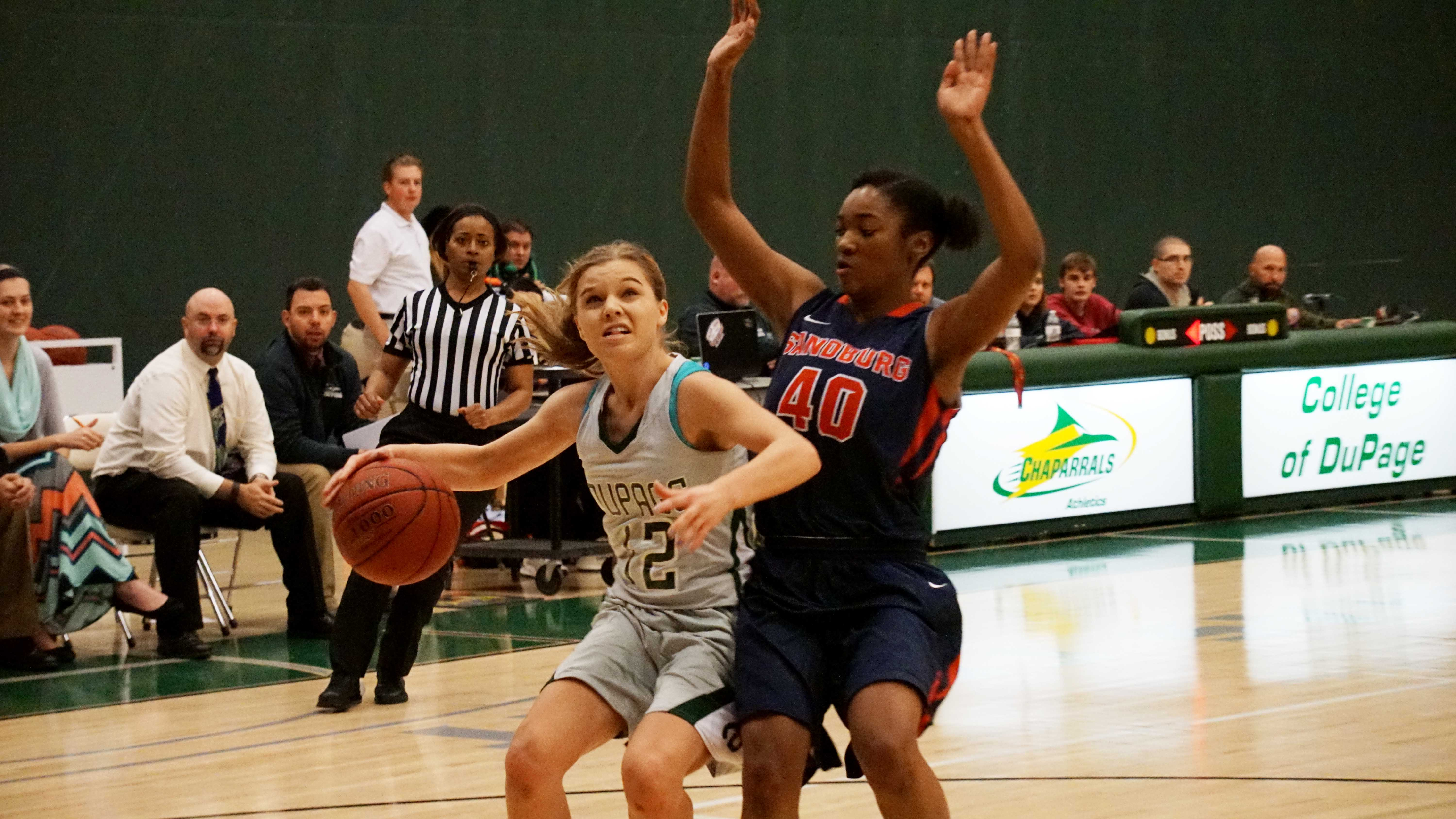 Chaparral guard #12 Elinor Cycenas challenges Carl Sandburg player in a match at the College of DuPage on Nov. 28.