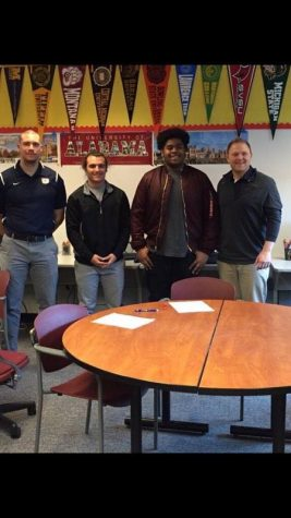 Dante Little (second from right) after he committed to play for COD