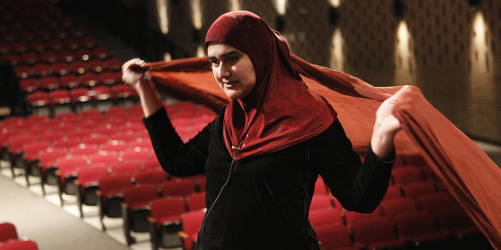 Playwright and actress Rohina Malik, formerly of Skokie and a Niles North High School graduate, prepares April 13, 2011 for a performance at Niles North, where she did three monologues as Muslim women characters. (Chris Walker/Chicago Tribune/MCT via Getty Images)
