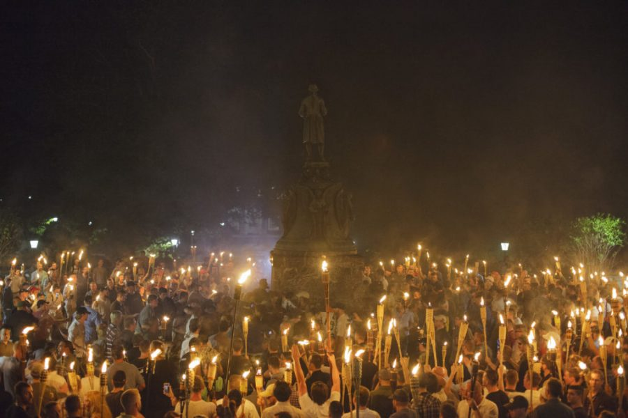 Neo+Nazis%2C+Alt-Right%2C+and+White+Supremacists+encircle+counter+protestors+at+the+base+of+a+statue+of+Thomas+Jefferson+after+marching+through+the+University+of+Virginia+campus+with+torches+in+Charlottesville%2C+Va.%2C+USA+on+August+11%2C+2017+%28Photo+by+Shay+Horse%2FNurPhoto%29%28Sipa+via+AP+Images%29