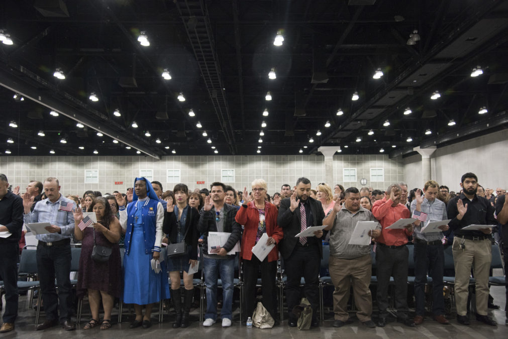 LOS ANGELES, CA   April 17, 2018 The newest U.S. citizens raise their right hands and take an oath during a Naturalization Ceremony at the Los Angeles Convention Center on April 17, 2018. Over 7,100 people from over 100 different countries were naturalized today - 32 percent were from Mexico. (Melissa Lyttle for Reveal)
