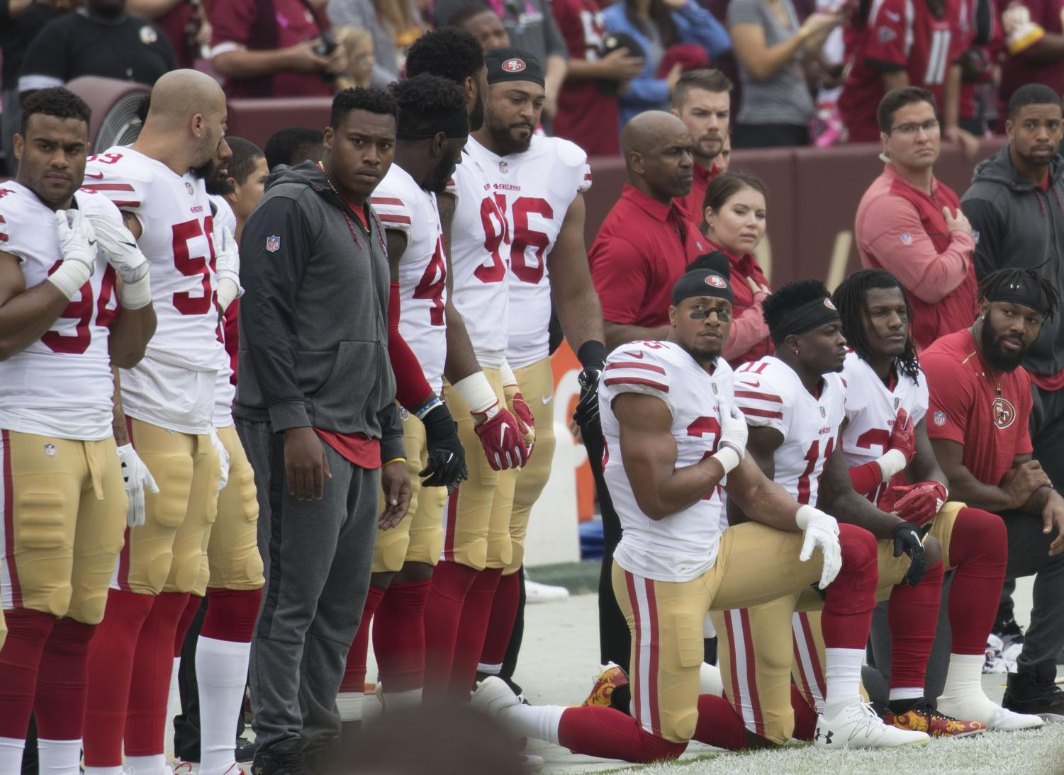 NFL players kneel in protest of police brutality during National Anthem, stirring a partisan debate