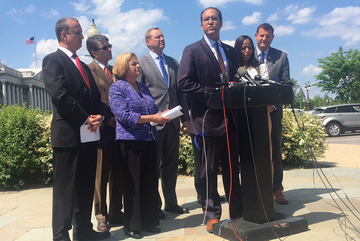 U.S. Rep Will Hurd, R-Helotes, center, speaks to reporters about an effort to force a debate on immigration legislation in the U.S. House, on May 9, 2018.