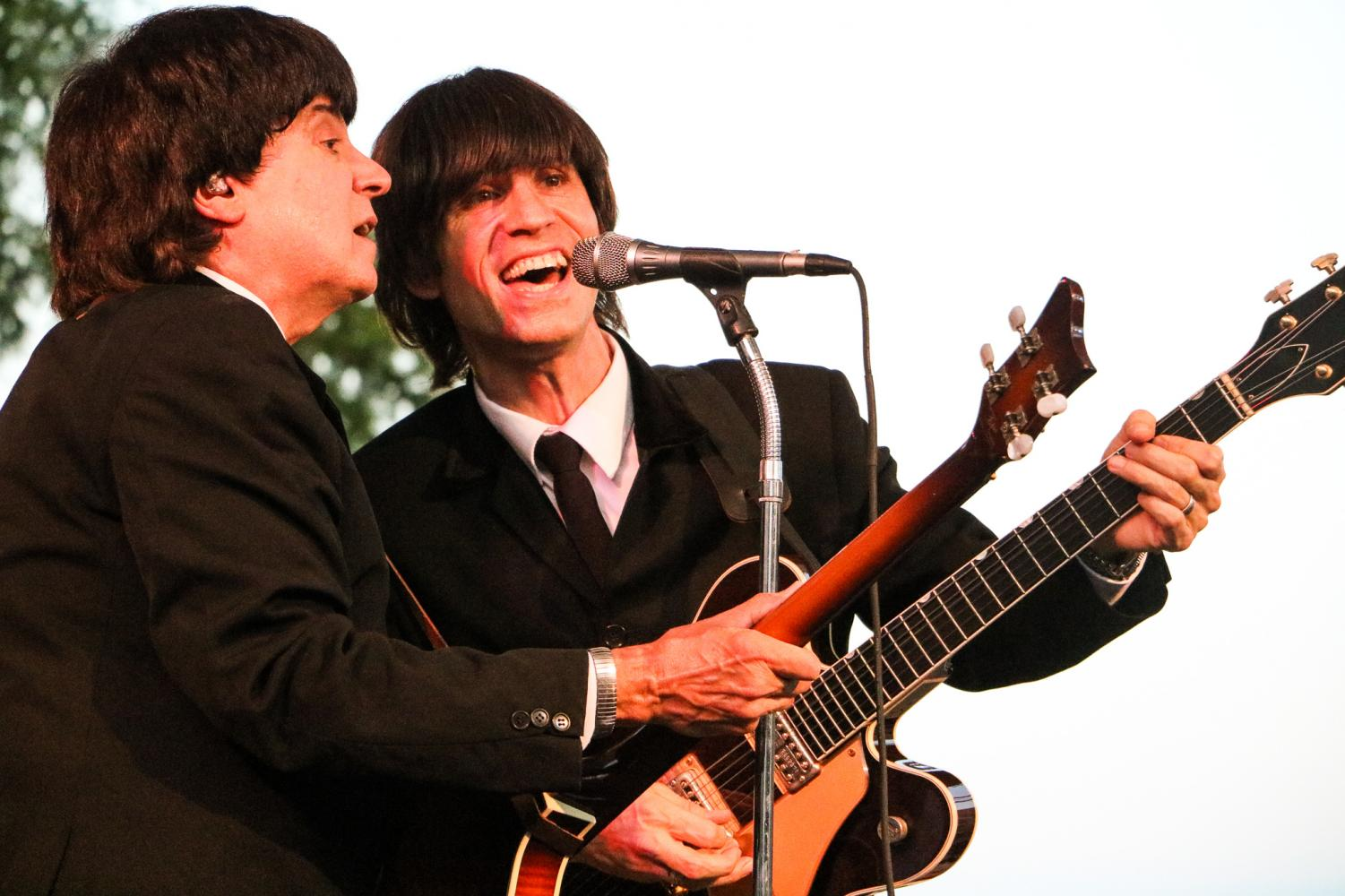 Photo by Alison Pfaff: Eric Michaels (left) (as Paul McCartney) and James Paul Lynch (right) (as George Harrison) of American English. The band uses vintage equipment like Michaels' Hofner Beatle bass and Vox amps to get that classic Beatle sound.