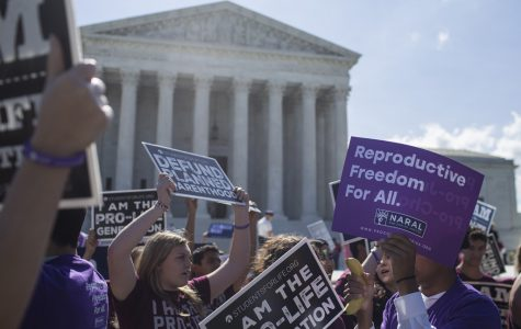 WASHINGTON, DC - JUNE 25: Abortion opponents and supporters hold signs in front of the U.S. Supreme Court on June 25, 2018 in Washington, DC. The high court is expected to issue decisions in six remaining cases, including the travel ban, public sector unions and redistricting, ahead of their end-of-June deadline this week.  (Photo by Zach Gibson/Getty Images)