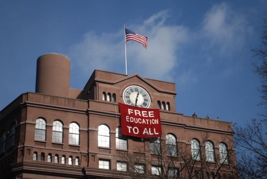 Students+hang+banner+below+the+historic+clock+tower+of+the+Cooper+Union+Foundation+building+in+New+York+City+during+a+december+occupation+in+protest+of+the+possibility+of+implementing+tuition+in+the+historically+free+school.