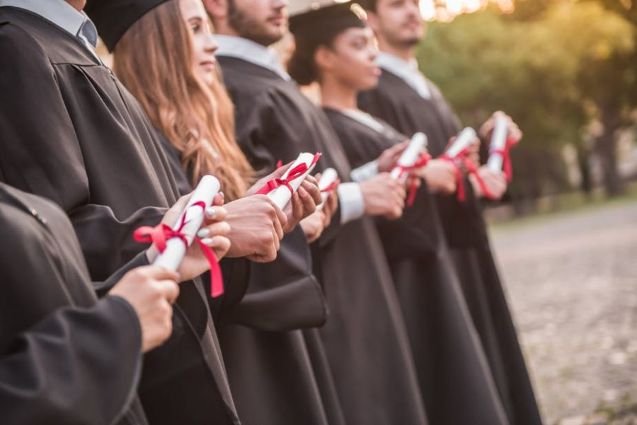 Colleges are increasingly being judged on how many students graduate. But is tying funding to graduation rates the way to go? George Rudy/Shutterstock.com