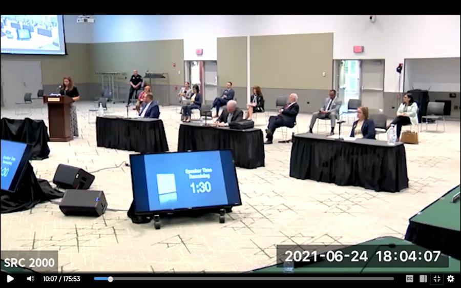 Political science professor Melissa Mouritsen (far left) speaking to COD Board of Trustees in June.