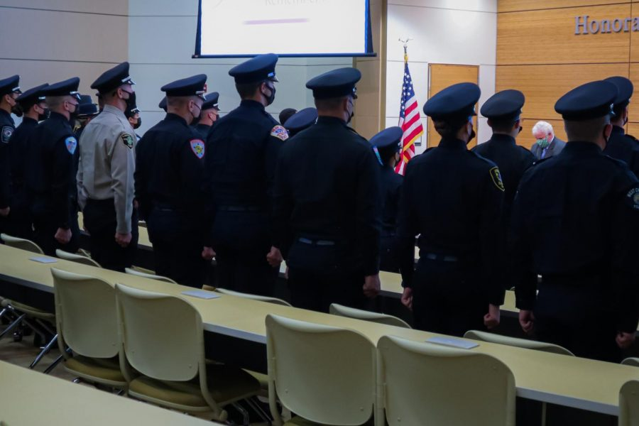 Area first responders, COD students and attendees stand at attention during CODs 9/11 20th anniversary commemoration ceremony on Saturday, Sept. 11, 2021.