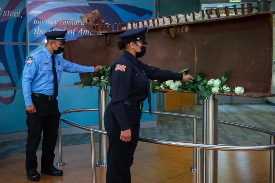 Area first responders lay white roses upon a beam from the World Trade Center during ceremonies commemorating the twentieth anniversary of 9/11 on Saturday, September 11, 2021.