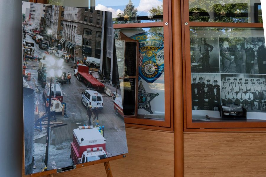 Photographs from 2001 on display during 9/11 commemorative ceremonies at College of DuPage on Saturday, Sept. 11, 2021. The photos are from the personal collection of Michael Fagel, a homeland security subject matter expert at COD who was at Ground Zero for 100 days in 2001.
